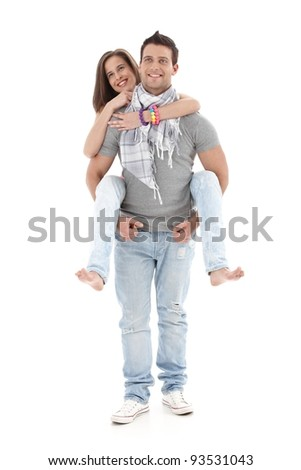 Portrait of goodlooking boyfriend carrying girl on back, laughing, having fun, isolated on white, full size.?