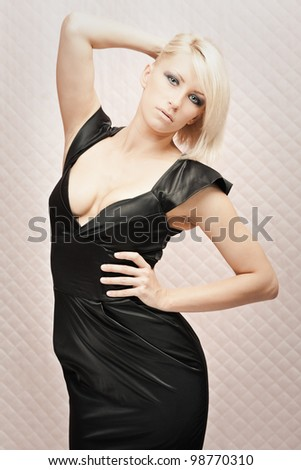 Portrait of gorgeous blond woman in long black dress - stock photo
