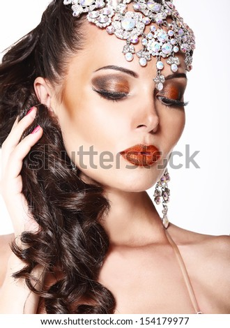 Portrait of Gorgeous Dreamy Woman with Shining Jewels
