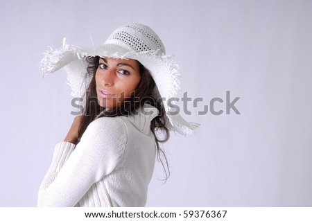 portrait of gorgeous woman posing with a hat