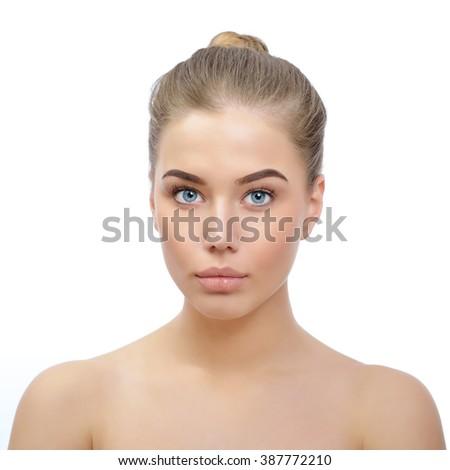 Portrait of gorgeous woman. Pretty girl over white background. Beautiful female face. Skincare, beauty treatment, spa, suntan, cosmetology. - stock photo