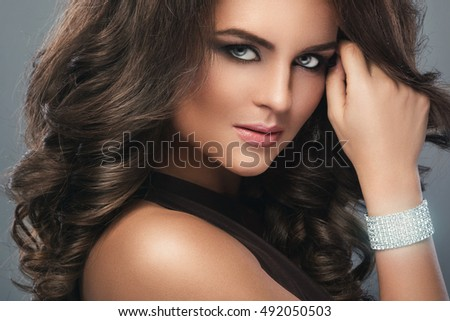 Portrait of gorgeous woman with beautiful makeup and hairdo