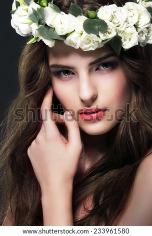 Portrait of Gorgeous Woman with Wreath of Flowers - stock photo