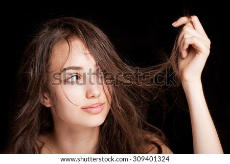 Portrait of gorgeous young brunette woman with wet hair.