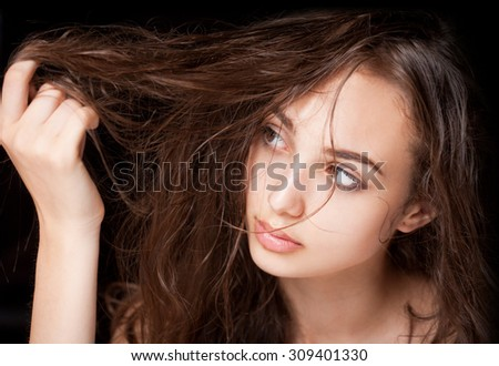 Portrait of gorgeous young brunette woman with wet hair. - stock photo