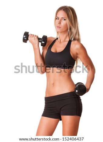 Portrait of gorgeous young fit blond woman working out with barbells.