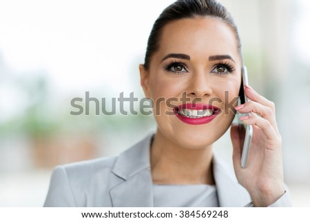 portrait of gorgeous young office worker making phone call - stock photo