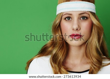 Portrait of gorgeous young tennis player against green  - stock photo