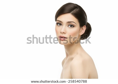 Portrait of gorgeous young woman with perfect skin isolated on white background - stock photo