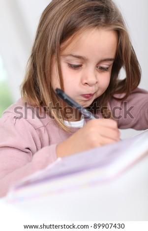 Portrait of grade-schooler doing homework - stock photo