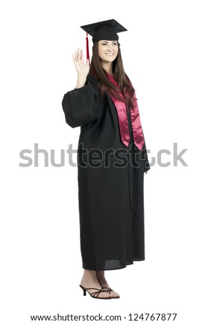 Portrait of graduating student waving her hand against white background