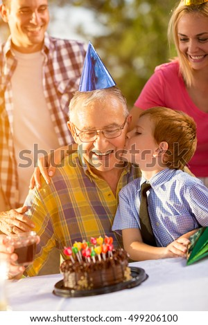 Portrait of grandfather and grandson celebrating birthday
