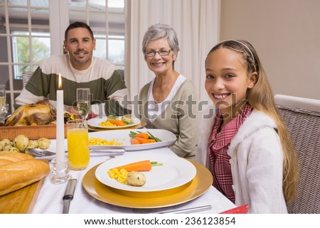 Portrait of grandmother father and daughter at christmas at home in the living room - stock photo