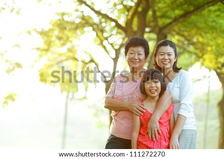 Portrait of grandmother, mother and grandchild - stock photo