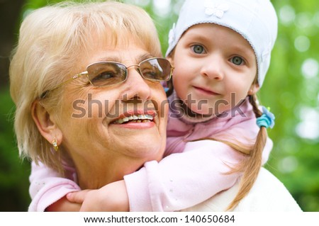 Portrait Of Grandmother With Granddaughter Relaxing Together - stock photo