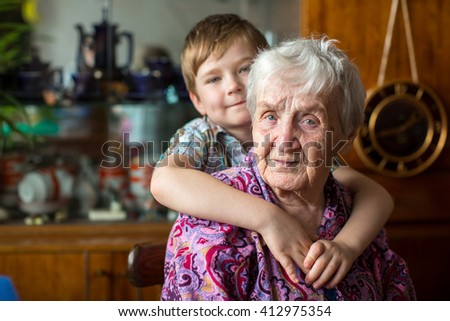 Portrait of grandmother with her grandson. - stock photo
