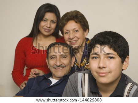 Portrait of grandparents with adult daughter and grandson - stock photo