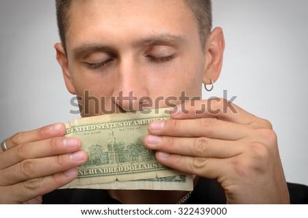 portrait of greedy man holding dollars  - stock photo