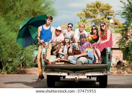 Portrait of Groovy Group in the Back of Truck - stock photo