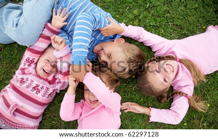 portrait of group children playing on the grass