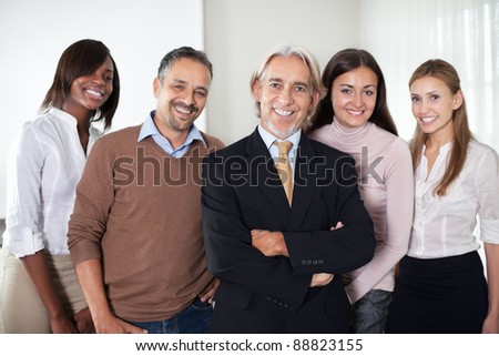 Portrait of group of business people confidently standing together