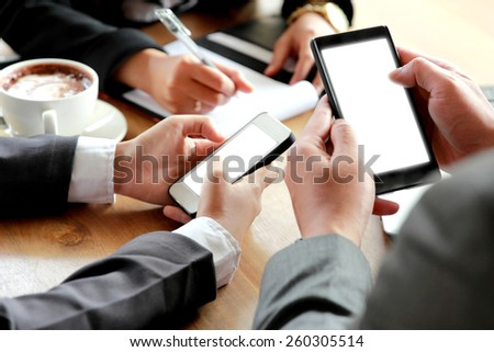 portrait of group of business people using smartphone - stock photo