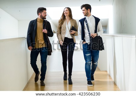 Portrait of group of business people working in modern office. - stock photo