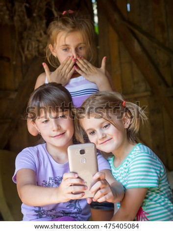 Portrait of group of childrens taking a selfie