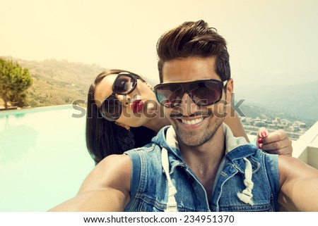 Portrait of group of friends taking photos with a smartphone,Couples taking Selfie - stock photo