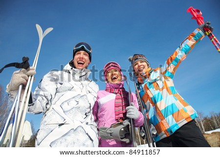 Portrait of group of friends with skis - stock photo