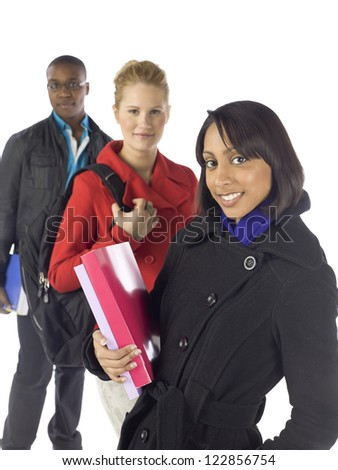 Portrait of group of multicultural college students against white background