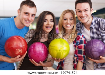 Portrait of group of people at the bowling alley