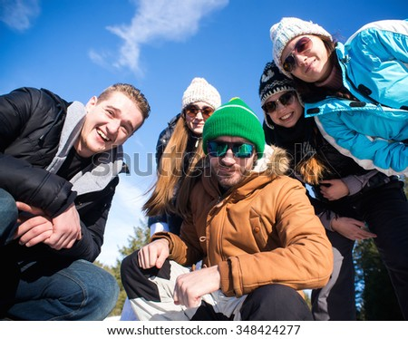 Portrait of Group of teenagers have a good time in winter.