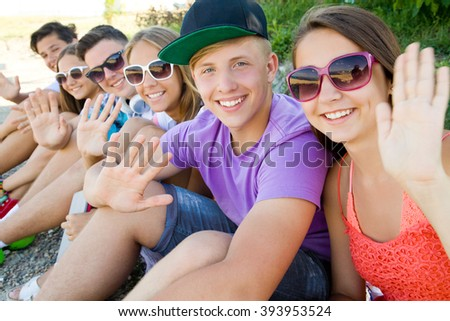 portrait of group of teenagers spending time together - stock photo