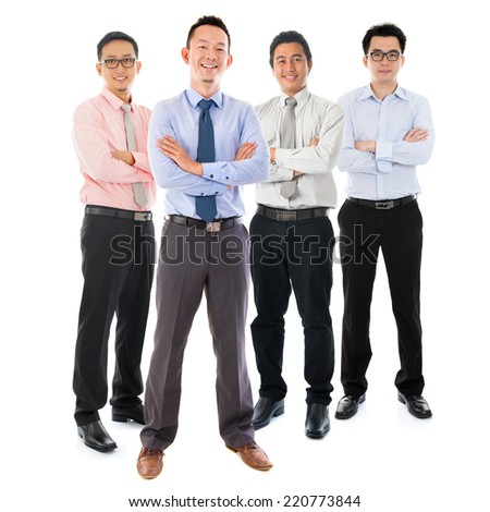Portrait of group Southeast Asian businessmen standing isolated on white background - stock photo