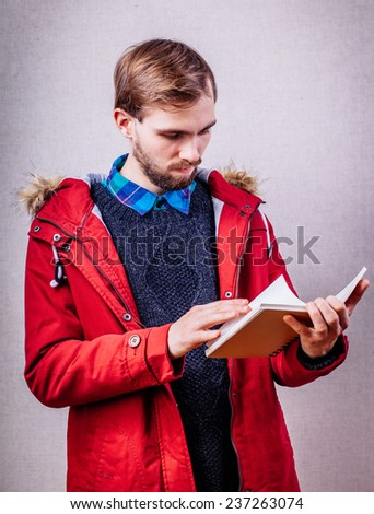 Portrait of guy writing in his organizer - stock photo