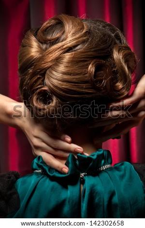 Portrait of hair retro style in dark green dress - stock photo