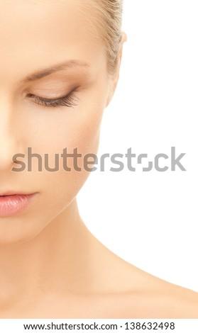 portrait of half face of beautiful woman - stock photo