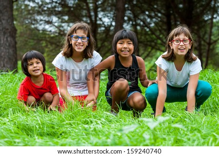 Portrait of handicapped girls with latin friends on farm. - stock photo