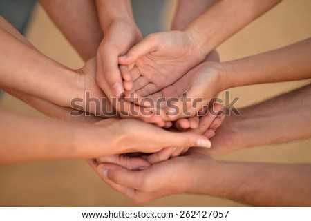 Portrait of hands of a family together closeup