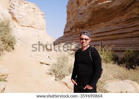 Portrait of handsom man traveling - stock photo