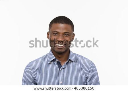 Portrait of handsome Afro-American man posing in studio. Happy man in blue shirt looking at camera over white background.