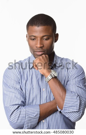Portrait of handsome Afro-American man posing with his arms crossed or folded while posing over white background in studio.