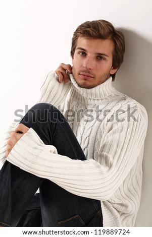 Portrait of handsome and attractive man in white sweater