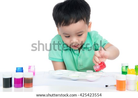 Portrait of handsome asian boy holding brush drawing. shooting in the studio on white background.