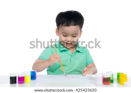 Portrait of handsome asian boy holding brush drawing. shooting in the studio on white background. - stock photo