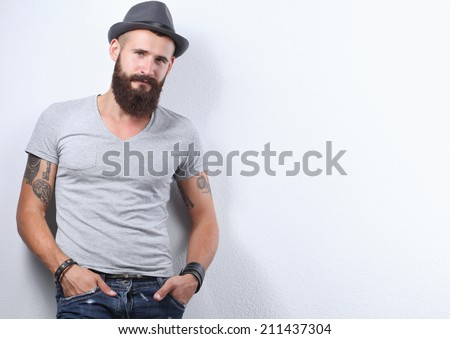 Portrait of handsome bearded man in hat standing , isolated on - stock photo