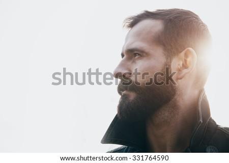 portrait of handsome bearded man in sunlight