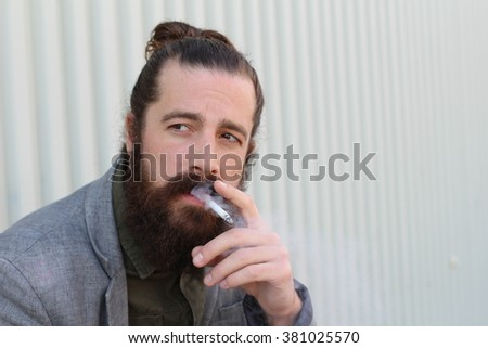 Portrait of handsome bearded man smoking