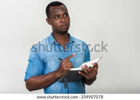 Portrait of handsome black African American man - stock photo